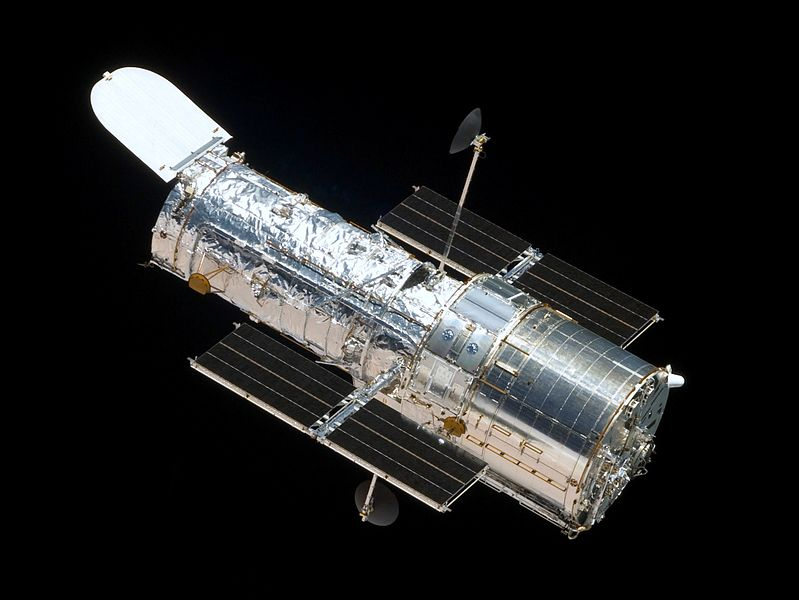 he Hubble Space Telescope as seen from the departing Space Shuttle Atlantis, flying Servicing Mission 4 (STS-125), the fifth and latest human spaceflight to it. Image from NASA.