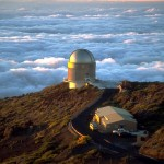 The Nordic Optical Telescope (NOT) telescope at Roque de los Muchachos Observatory in June 2001. The height of the observatory above the Atlantic Ocean ensures that it is almost always above the clouds. Image courtesy of Wikipedia.