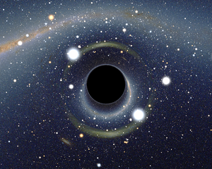 Simulated view of a black hole (center) in front of the Large Magellanic Cloud. Note the gravitational lensing effect, which produces two enlarged but highly distorted views of the Cloud. Across the top, the Milky Way disk appears distorted into an arc.