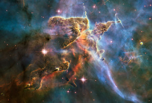 Star Birth: Carina Nebula, a sprawling and complex Escher-like region of gas and dust about 7500 light years away. It's the scene of chaotic star birth and death, slammed and reslammed by winds from stars being born and others busy blowing up.