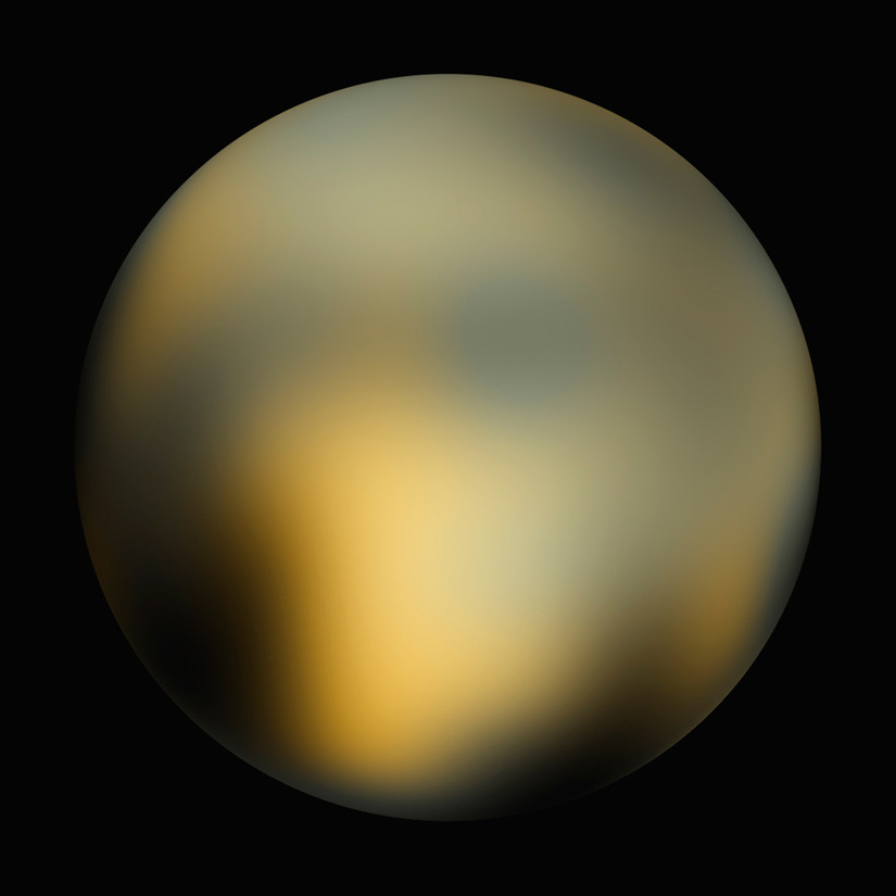 Pluto, as seen by the Hubble Space Telescope (Credit: NASA).