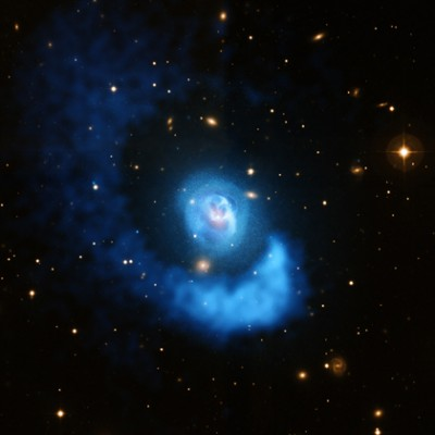 Vast clouds of hot gas are sloshing back and forth in Abell 2052, a galaxy cluster located about 480 million light years from Earth. X-ray data (blue) from NASA's Chandra X-ray Observatory shows the hot gas in this dynamic system, and optical data (gold) from the Very Large Telescope shows the galaxies.