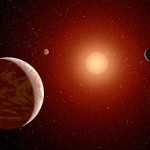 This artist's concept illustrates a young, red dwarf star surrounded by three planets. NASA