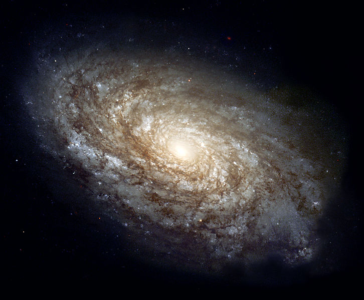 NGC 4414, a typical spiral galaxy in the constellation Coma Berenices, is about 55,000 light-years in diameter and approximately 60 million light-years away from Earth. NASA