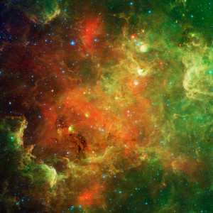 This swirling landscape of stars is known as the North American nebula. In visible light, the region resembles North America, but in this new infrared view from NASA's Spitzer Space Telescope, the continent disappears.