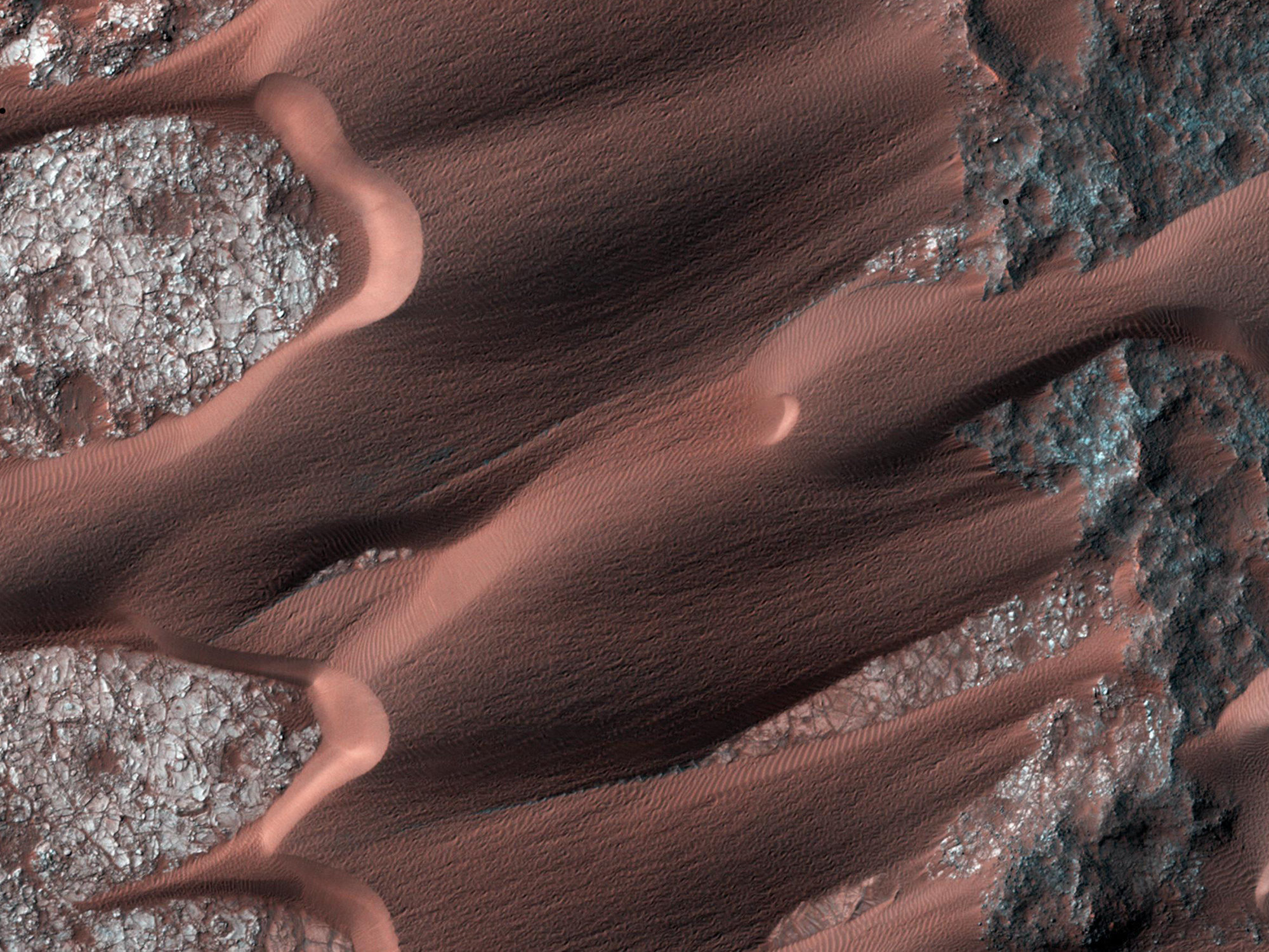 Ice adjacent to Martian dunes