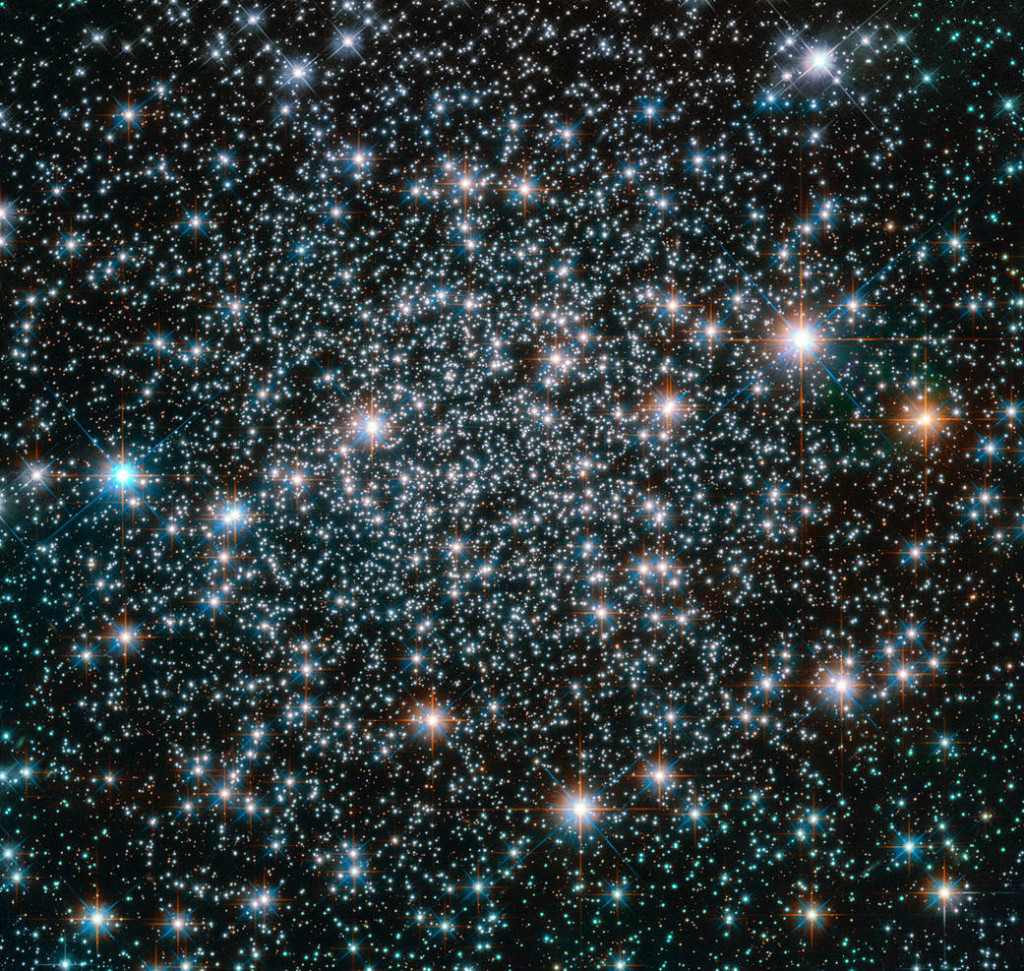 This 10.5-billion-year-old globular cluster, NGC 6496, is home to heavy-metal stars of a celestial kind! The stars comprising this spectacular spherical cluster are enriched with much higher proportions of metals — elements heavier than hydrogen and helium, are in astronomy curiously known as metals — than stars found in similar clusters. A handful of these high-metallicity stars are also variable stars, meaning that their brightness fluctuates over time. NGC 6496 hosts a selection of long-period variables — giant pulsating stars whose brightness can take up to, and even over, a thousand days to change — and short-period eclipsing binaries, which dim when eclipsed by a stellar companion. The nature of the variability of these stars can reveal important information about their mass, radius, luminosity, temperature, composition, and evolution, providing astronomers with measurements that would be difficult or even impossible to obtain through other methods. NGC 6496 was discovered in 1826 by Scottish astronomer James Dunlop. The cluster resides at about 35 000 light-years away in the southern constellation of Scorpius (The Scorpion).